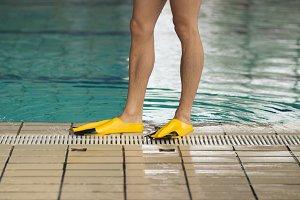 swimmer legs fins water pool