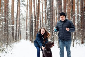 Couple with a Dog Having Fun