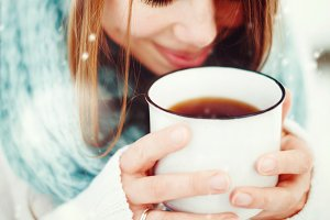 Female Drinking Hot Drink