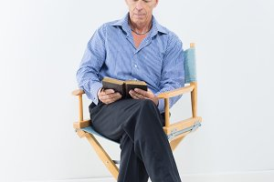Middle-aged man reading a bible