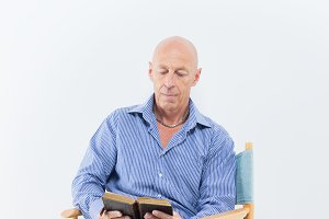 40s Man reading a bible/book