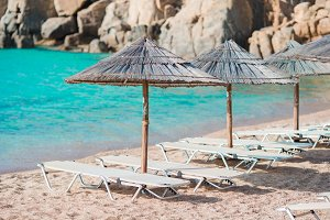 Beach wooden chairs and umbrellas for vacations on beach in Europe