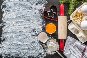 Christmas baking background with utencils and ingredients