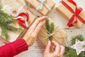 Female hands decorating presents