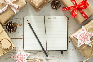 Making list of presents on wood background