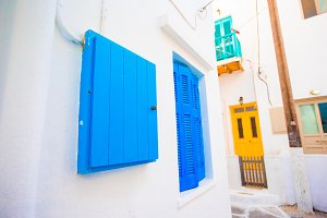 Traditional houses with colorful doors in the narrow streets of Mykonos, Greece.