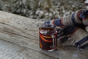 Hands holding cup of mulled wine
