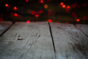 Rustic table with christmas lights blured in background