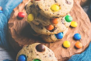 Chocolate chip cookies with colorful candies. toned