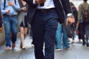 businessman walking on city street