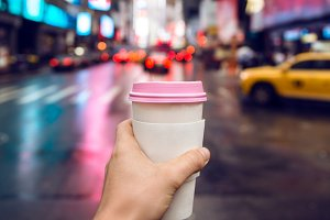 Coffee cup to go in the city
