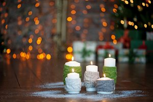 Christmas candles with knitted covers and other decorations
