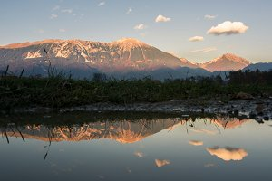 Mountain reflection in a pond