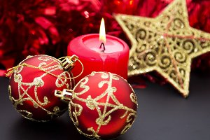 Burning candles with holiday decor