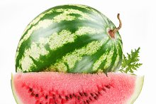 ripe watermelon with a slice on a white background