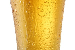 Beer in glass on a white