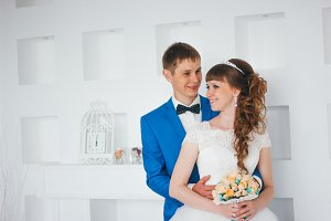 young bride and groom in interior design studio