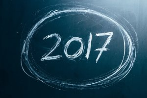 Year number 2017 written with the white chalk on the blackboard