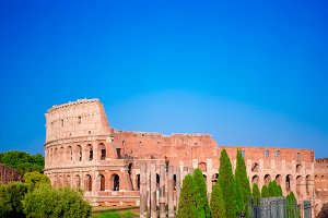 Colosseum or Coliseum background blue sky in Rome, Italy