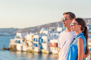 Family in Europe. Young couple on Little Venice background on Mykonos Island, in Greece