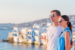 Family in Europe. Happy couple in Little Venice background on Mykonos Island, in Greece