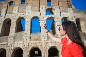 Happy girl with enjoy european vacation background Colosseum in Rome, Italy