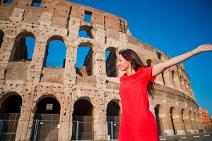 Young woman in front of Colosseum in Rome, Italy. Girl in Europe vacation
