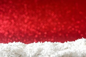 Snow and red glitter background