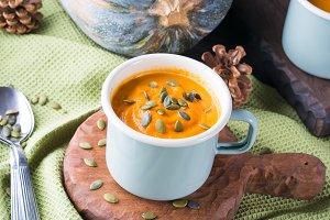 Pumpkin cream soup in green pastel mug