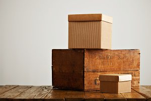 Blank corrugated cardboard boxes with vintage wooden box