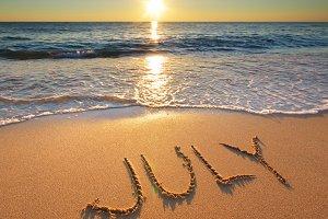 July word on sea sand
