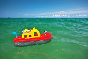 Toy ship boat and sea wave