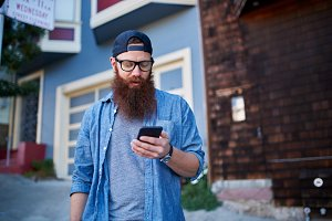 Hipster in San Francisco using phone