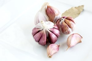 Purple garlic on white wooden table