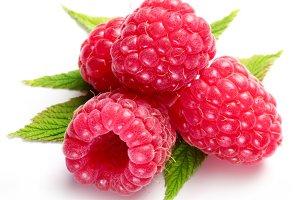 Macro shot of appetizing raspberries over white.