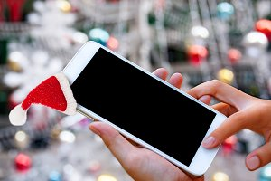 smartphone with Santa cap
