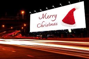 Billboard Christmas on night time.