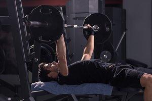 young man, bench weights bar lifting