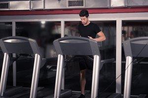 man running treadmill, gym indoors