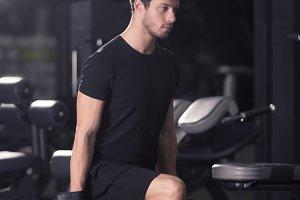 young man dumbbells leg squat gym