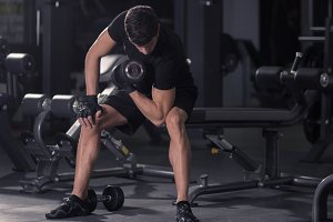 man fit athlete bicep curl dumbbells