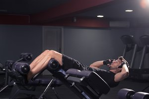 young man abs core bench gym indoors