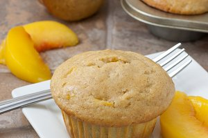 Peach Muffins on a counter.