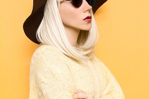 blond in fashion hat.