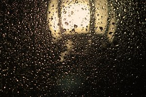 Raindrops and the light of a lantern