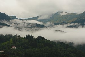 Mountains in the mist with a house