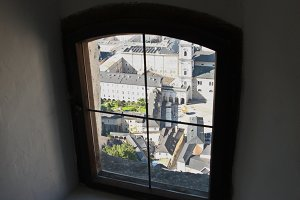 The old city in old window. Salzburg