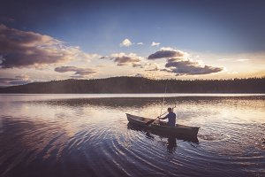 Fisherman on Lake before dusk