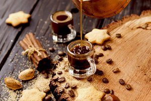 Turkish coffee in a small cup, cookies, selective focus