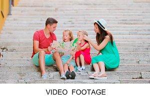 Two kids family sitting on ledder
